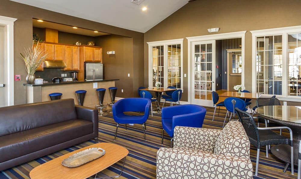 North Ponds Apartments Clubhouse Seating And Kitchen Area in Webster, NY