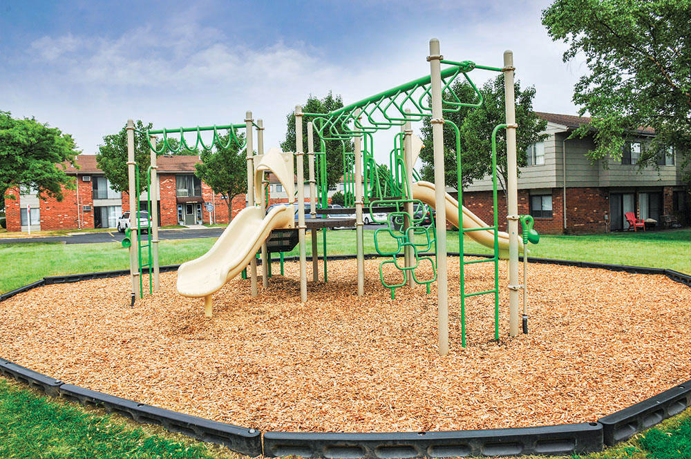 A children's play structure is onsite for your enjoyment at Crossroads Apartments