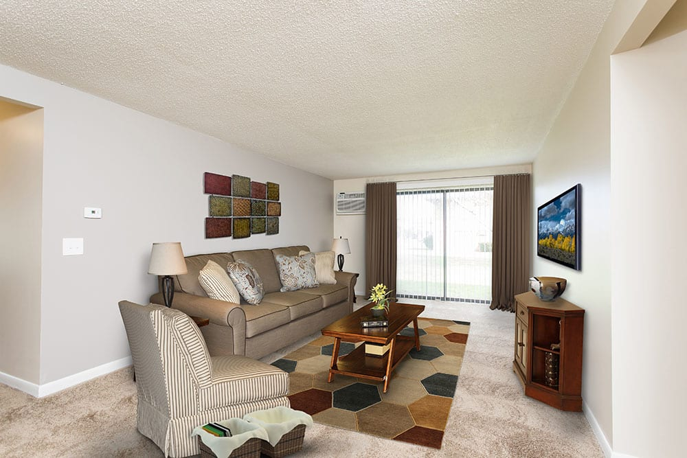 Spencerport apartments includes living rooms with attached patios