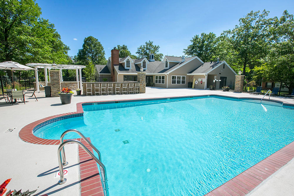 A swimming pool that is great for entertaining at Hunter's Chase Apartments in Westlake, OH