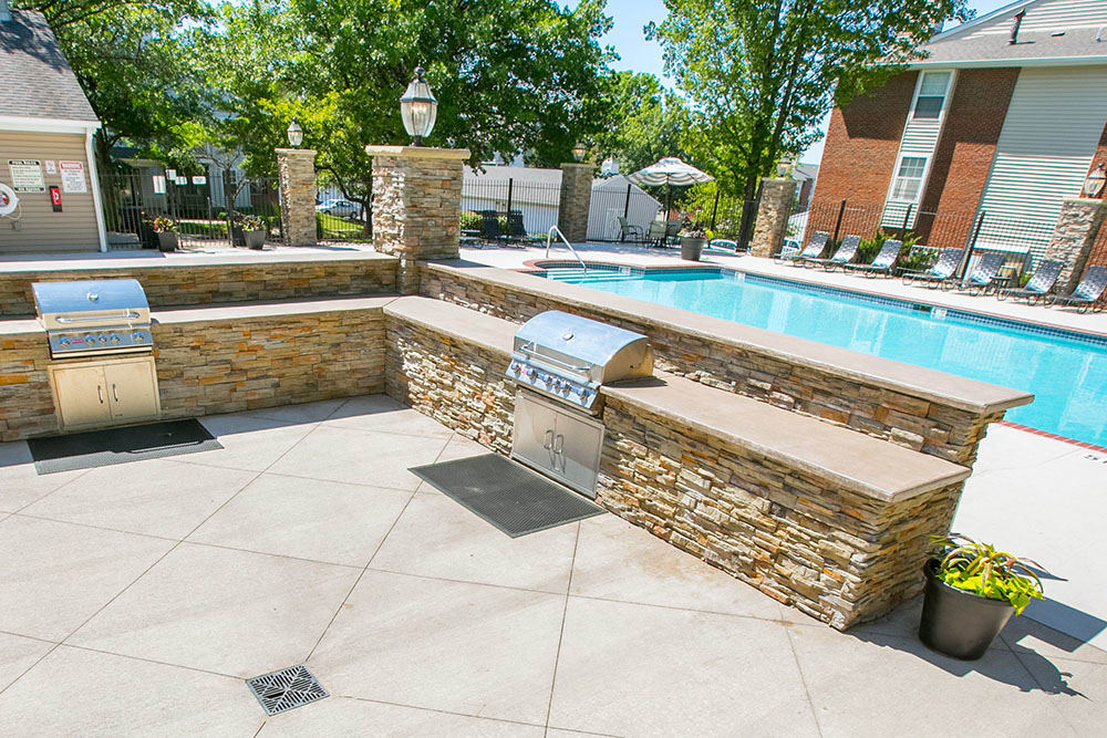 A bbq area that is great for entertaining at Hunter's Chase Apartments in Westlake, OH