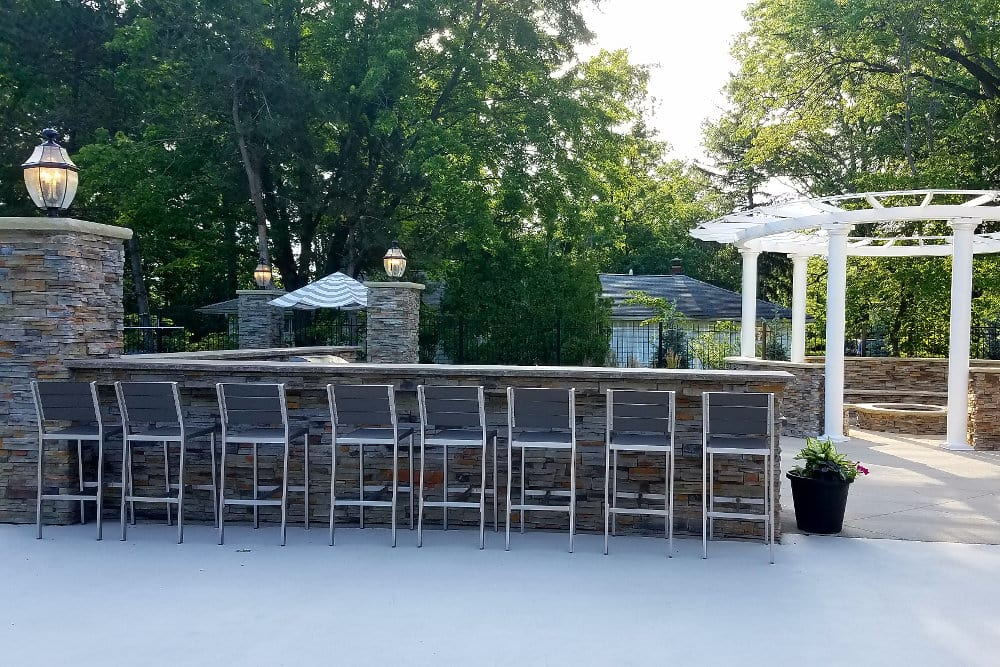 Outdoor fireside lounge and kitchen at Hunters Chase Apartments in Westlake, OH