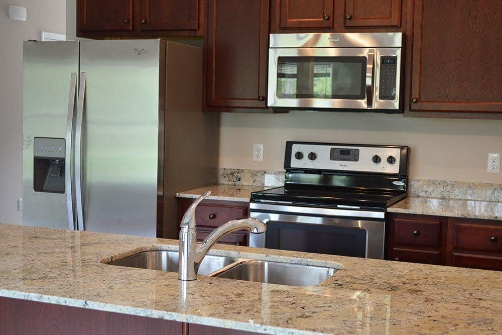 Enjoy granite inspired counter tops and modern appliances in your new kitchen at Village Path in Webster NY