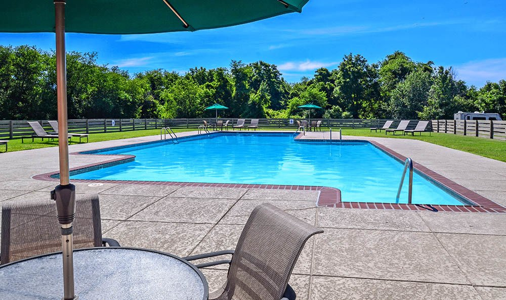 Outdoor lounging and swimming pool at The Reserve at Copper Chase