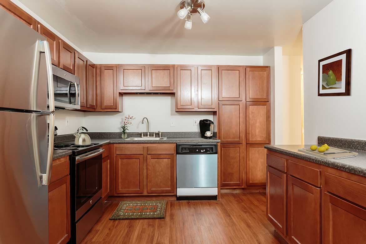 The kitchen is fully equipped for your convenience at Meadowbrook Apartments.