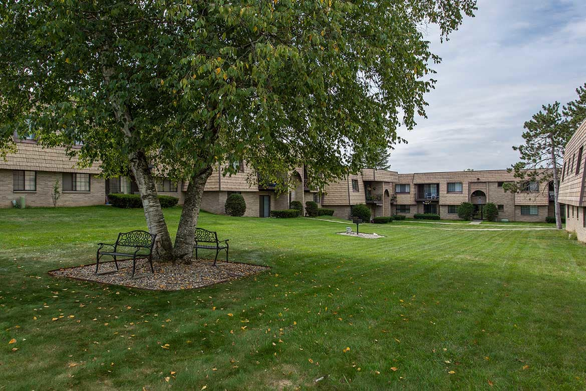 Socialize and hang out in the yard at Meadowbrook Apartments.