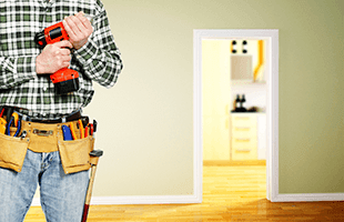 Maintenance man holding a screwdriver