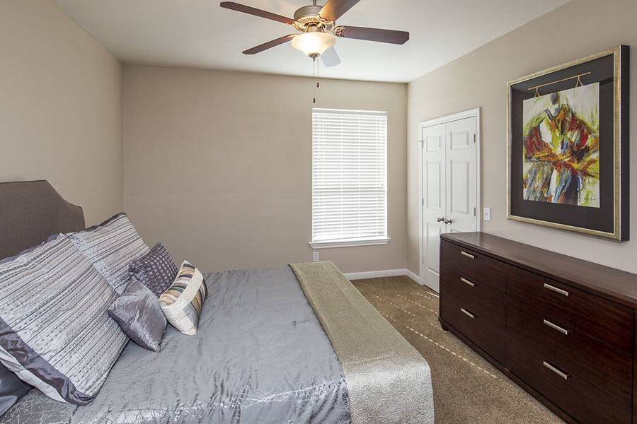 Example bedroom at apartments in in Texas City, TX