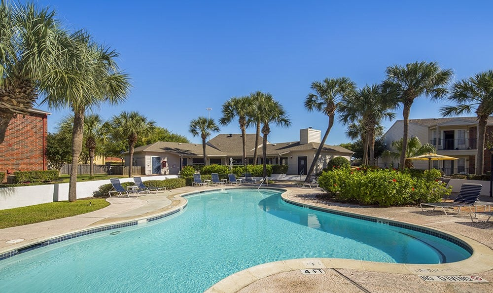 A sparkling pool is just one of the many amenities that Stone Ridge Apartments has to offer in Texas City TX