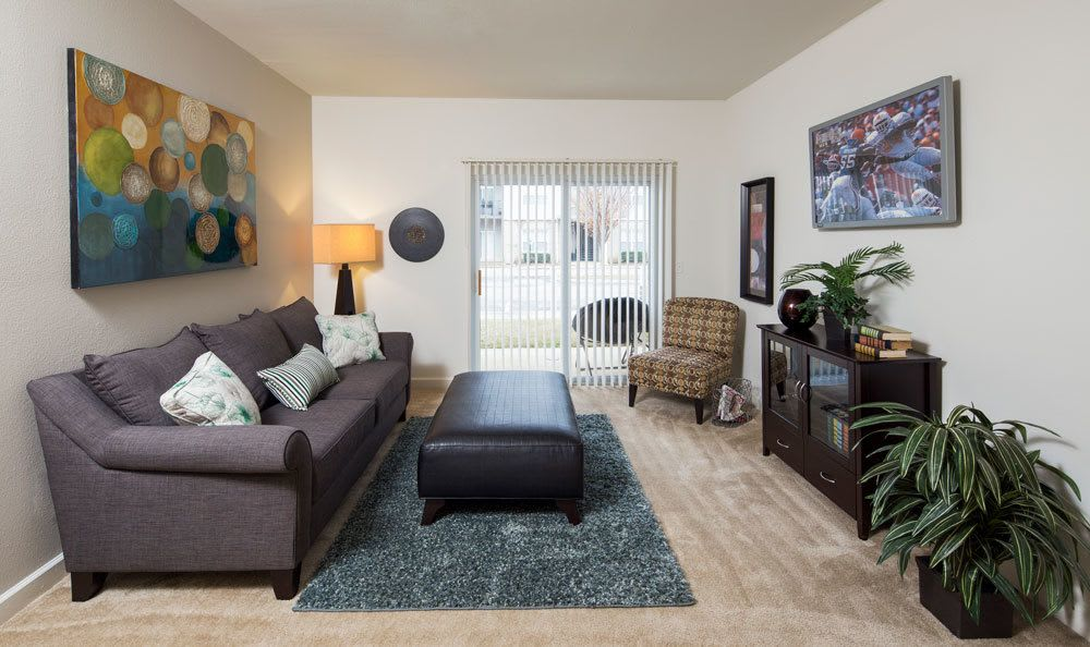 Memphis apartments includes living rooms with attached patios