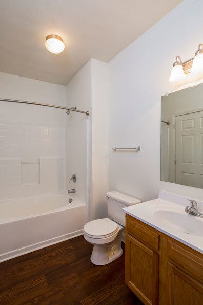 Example bathroom with hardwood floors at apartments in Memphis