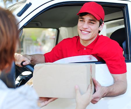 Driver handing a box to a woman