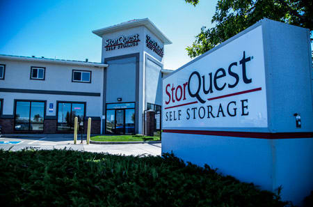 Entrance sign at StorQuest Self Storage in Aurora, CO