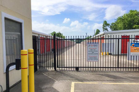 Gated entrance at self-storage in Friendswood, TX
