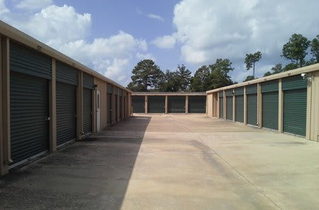 Outdoor storage units at StorQuest Self Storage in Spring