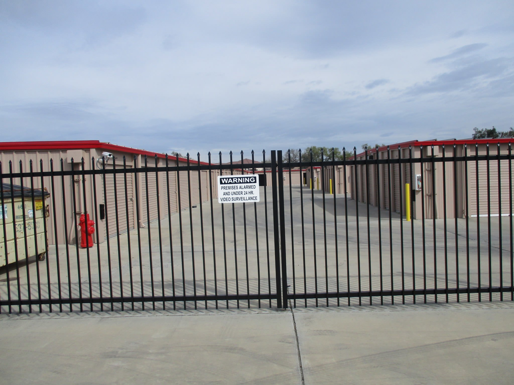 Exterior view of storage units at StorQuest Self Storage in Ceres, CA