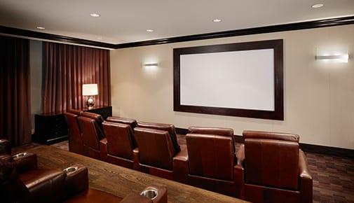 Host movie nights in a personal screening room at apartments in Atlanta, Georgia