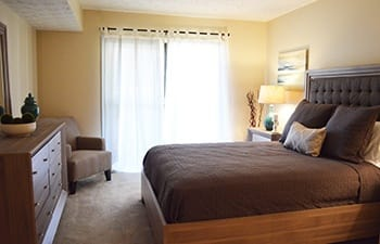 A bright and welcoming bedroom in our Clarkston apartments