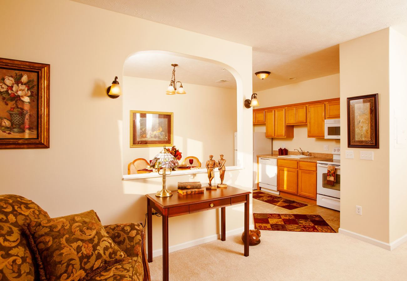 living room with open kitchen at assisted living community in Mentor, OH