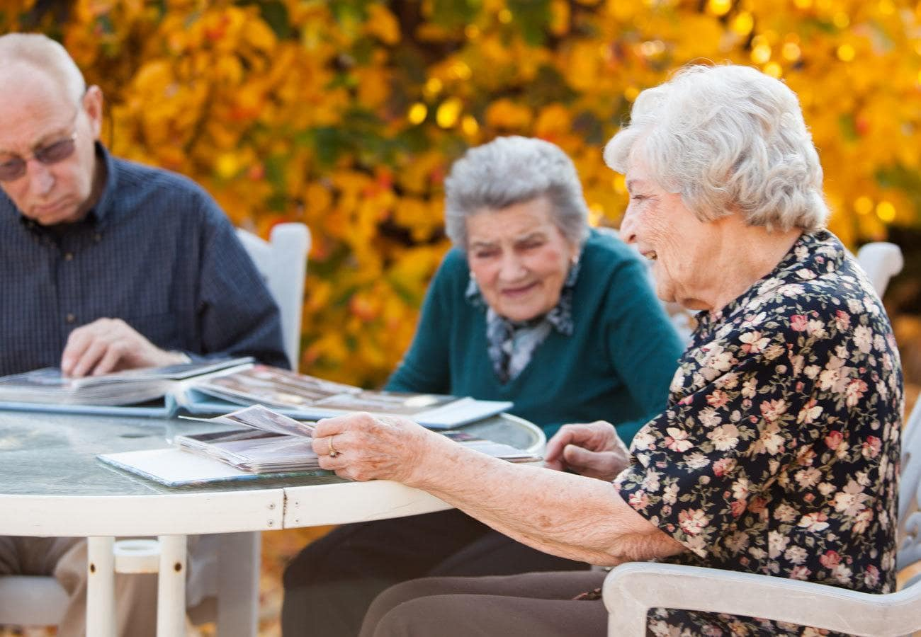 gather with friends and read outside at assisted living community in Mayfield Village, OH