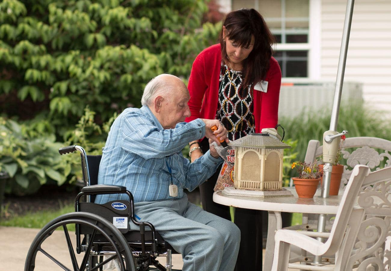 senior man helping with gardening at assisted living community in Mayfield Village, OH