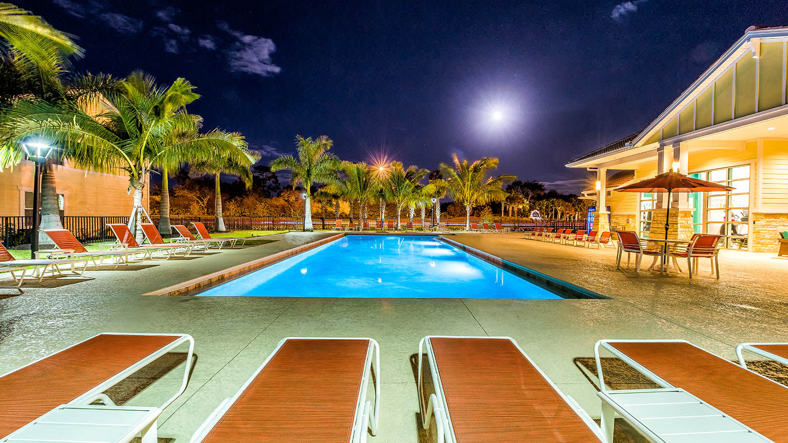 Swimming Pool At Night at Longitude 81 in Estero, FL