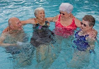 Swimming activities in Rainbow City senior living community