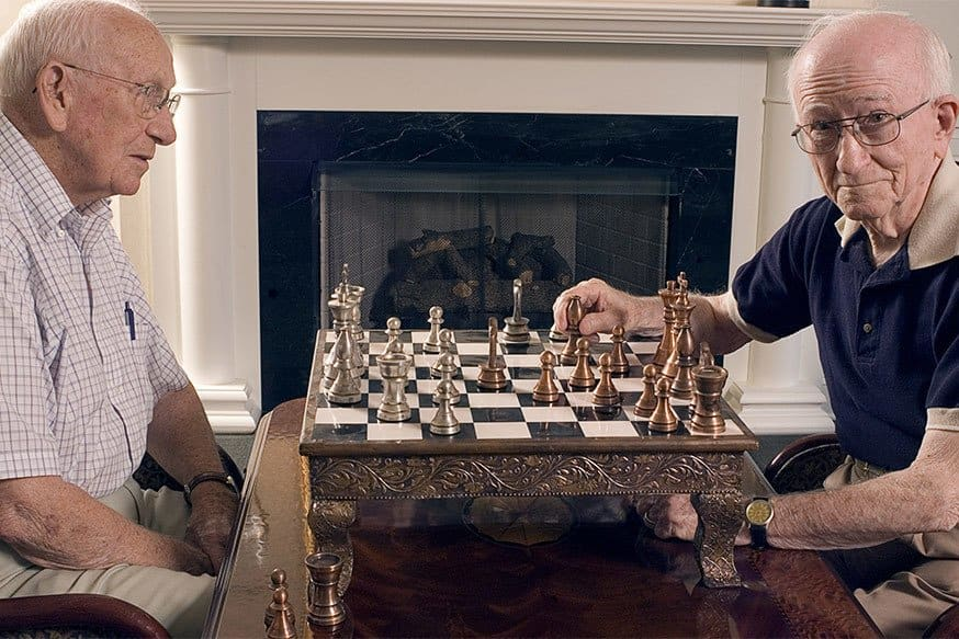 Play chess at the senior living facility in Rainbow City