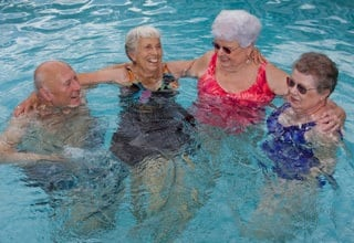 Residents swimming at the senior living in Rainbow City