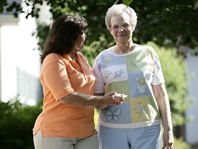 senior living resident and nurse in Auburn Hills