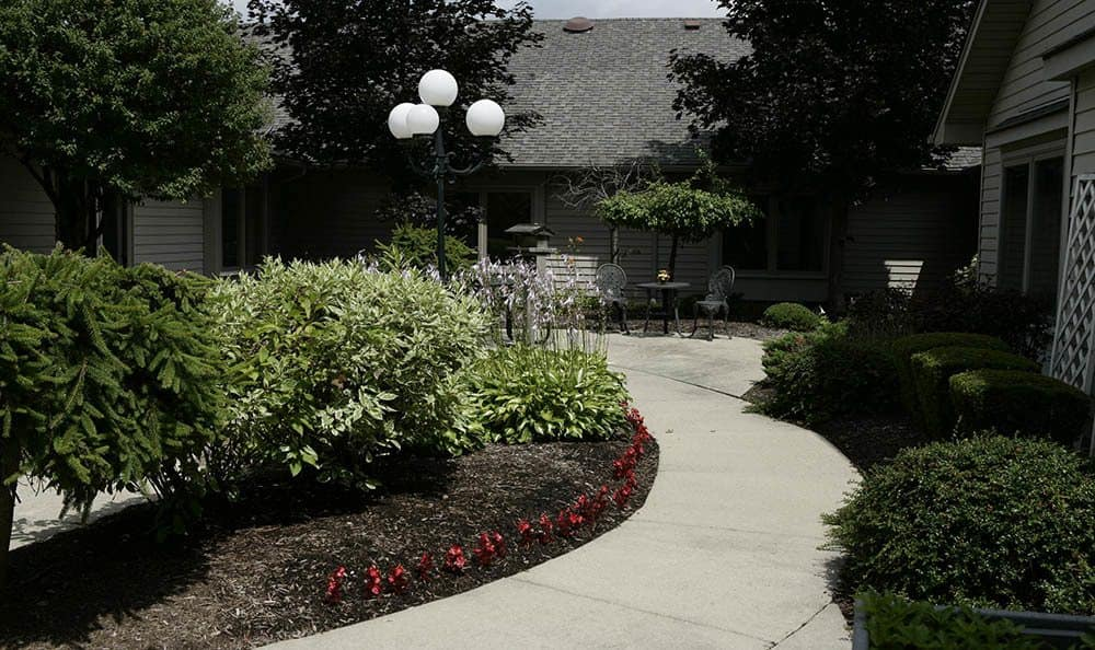Beautiful landscaping surrounds our Auburn Hills senior living facility