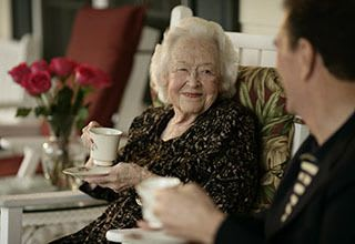 Residents enjoying tea at HarborChase of The Park Cities