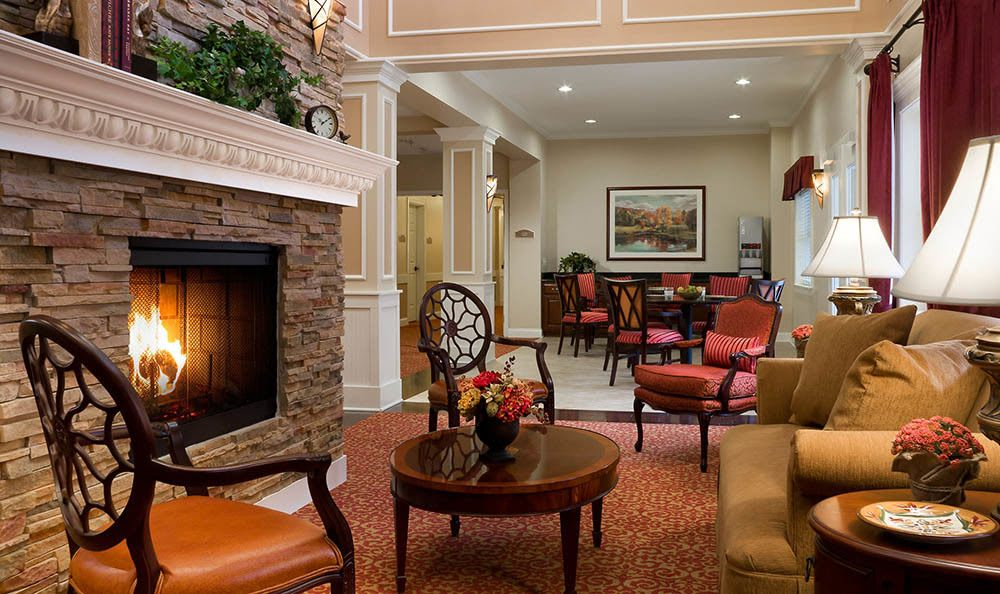 Sit by the fire at our senior living facility in Plainfield