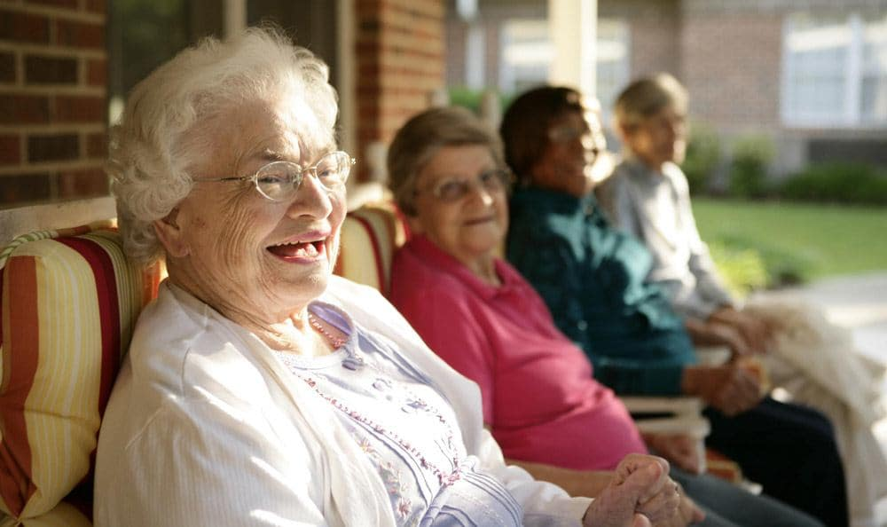 Relax outside at our senior living facility in Columbia