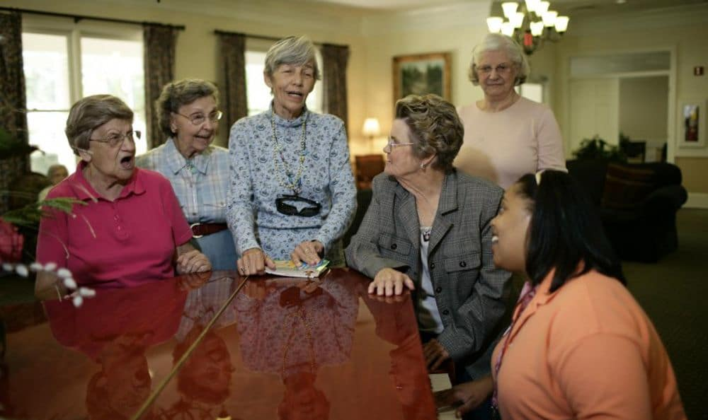 Sing with our wonderful staff at our senior living facility in Columbia
