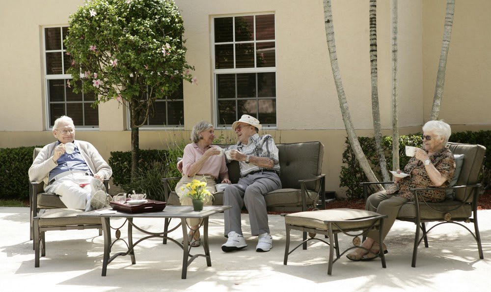 Relax outside at our senior living facility in Coral Springs