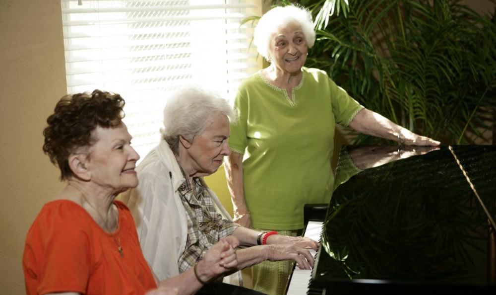 Sing with our wonderful staff at our senior living facility in Coral Springs
