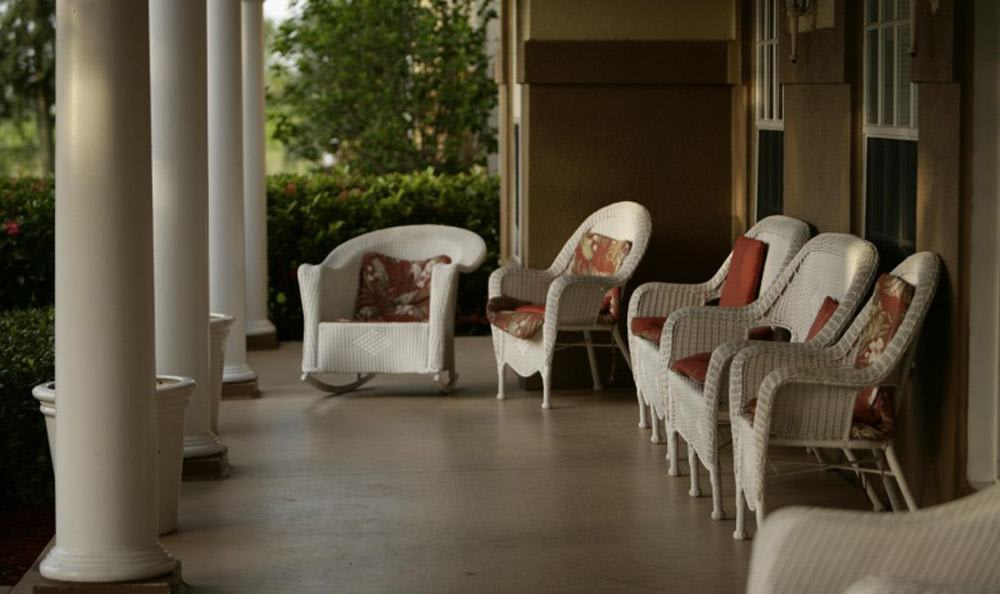 Relax outside at our senior living facility in Naples