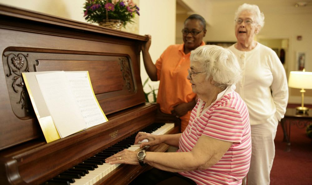 Sing with our wonderful staff at our senior living facility in Rock Hill