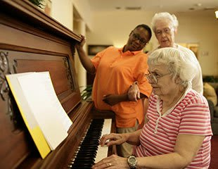 senior living residents play piano in Rock Hill