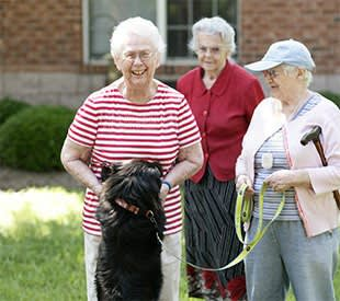 senior living resident and dog in Rock Hill