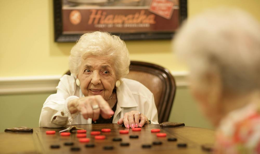 Enjoy games with friends and family at our senior living facility in Vero Beach