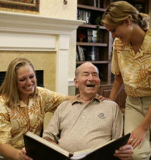 Happy senior living residents enjoy a good book in Naperville