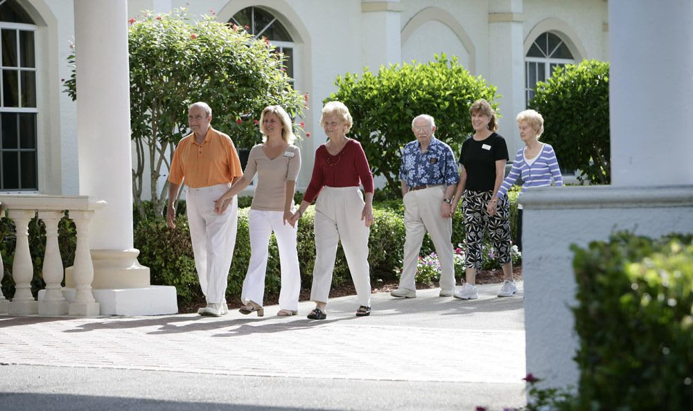 Take a beautiful walk around our senior living facility with our staff and friends in Naples