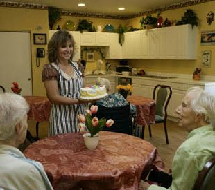Senior living residents enjoy cake in Naples