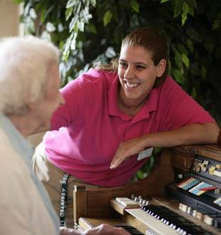 happy resident enjoys the piano in Wildwood