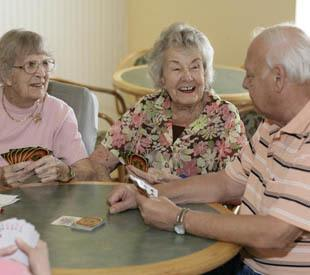 senior living residents enjoying a game of cards in Wildwood
