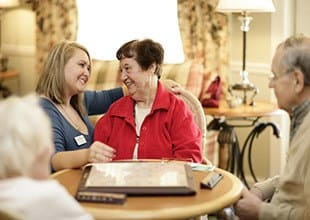Resident friends share a laugh at HarborChase