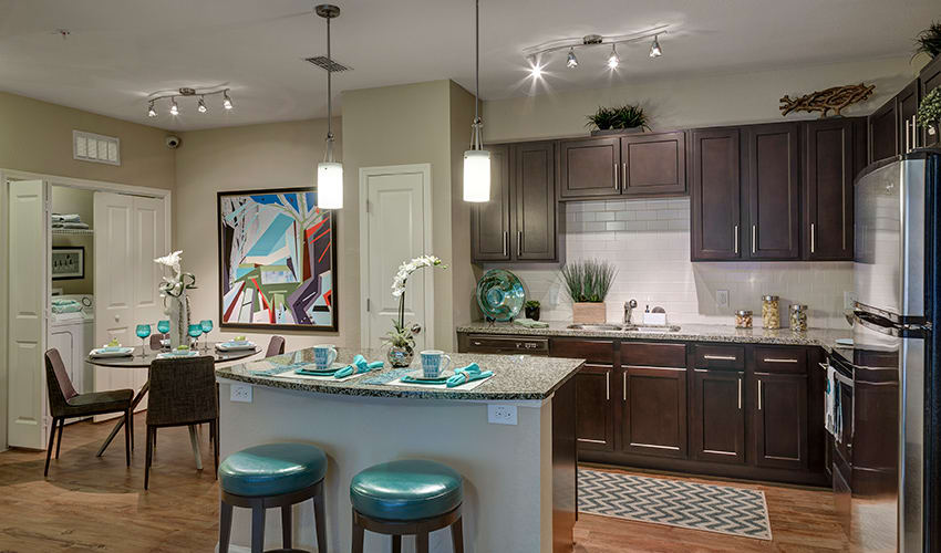 Open apartment kitchen at our luxury apartment community at Integra River Run