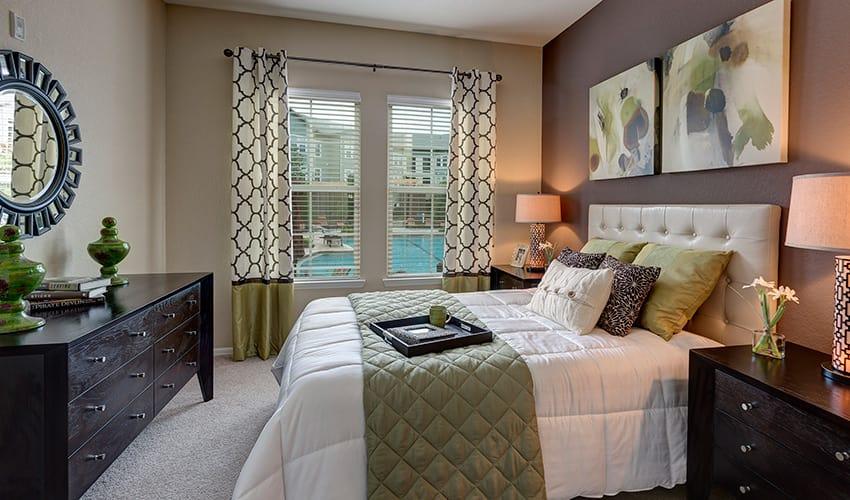 Luxurious apartment bedroom at Integra River Run